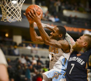 Denver Nuggets forward Will Barton (5) gets fouled by Memphis Grizzlies forward Chris Andersen (7) as he drives t the basket February 29, 2016 at Pepsi Center. (John Leyba, The Denver Post)