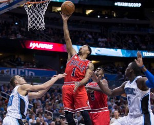 Photo: Willie J. Allen, Jr., AP  Chicago Bulls guard Derrick Rose (1) lays the ball up on Orlando Magic forward Aaron Gordon (00) and guard Victor Oladipo (5) during the first half of an NBA basketball game, Wednesday, March 2, 2016, in Orlando, Fla.