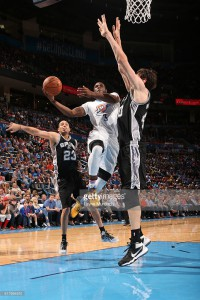 Dion Waiters #3 of the Oklahoma City Thunder goes for the lay up against the San Antonio Spurs during the game on March 26, 2016 at Chesapeake Energy Arena in Oklahoma City, Oklahoma. March 26, 2016| Credit: Layne Murdoch